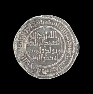 An example of a silver Damascus dirham dating back to 718-719, LACMA.